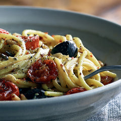 spaghetti with olives, tomatoes and black truffle mustard
