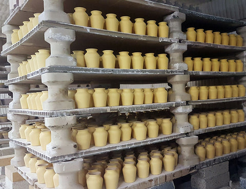 Maille mustard ceramic jars in oven