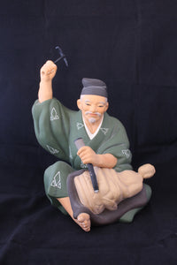 Vintage Japanese Hakta Urski doll original label ceramic figure seated man