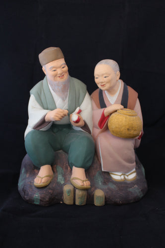 Vintage Japanese Hakta Urski doll original label ceramic figure seated man with woman