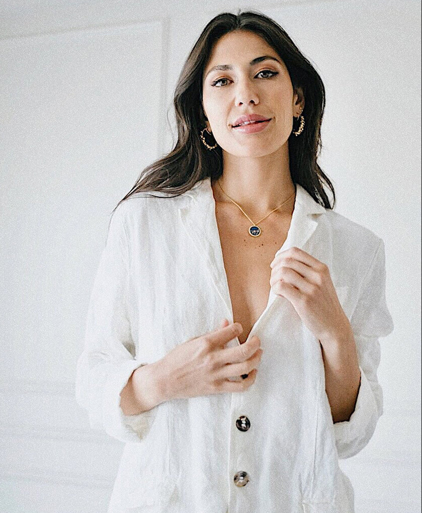 SARA MONTAZAMI WEARING CONSTELLATION REVERSIBLE ZODIAC CAPRICORN SIGN PENDANT NECKLACE