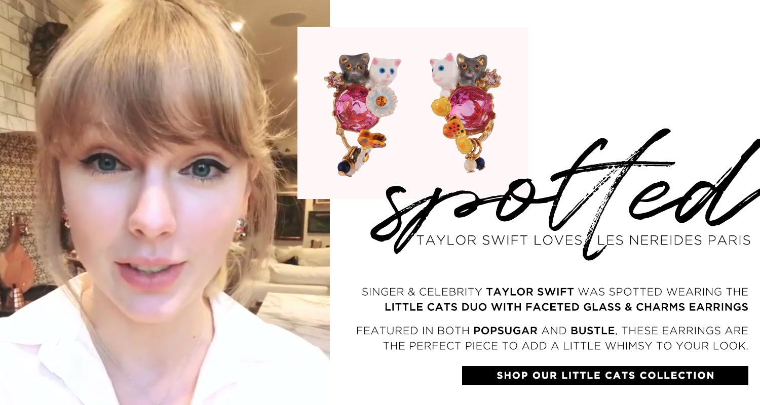 Taylor Swift Loves Les Nereides. Singer and Celebrity Taylor Swift was spotted wearing the little cats duo with faceted glass & charms earrings.