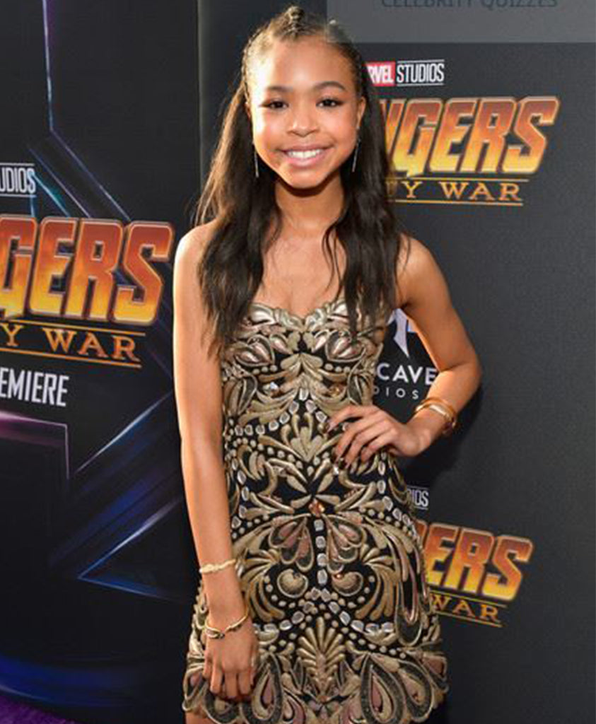 Actress Navia Robinson at the Avengers Infinity War Premiere wearing Les Néréides'  Blazing Nature Honey Alveoluses Semi-Rigid Bracelet
