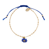 Free Flower Bracelet with Purchase of $150 or More
