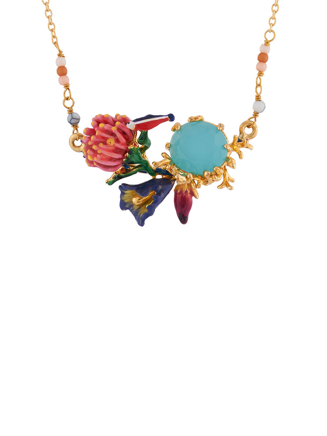 Mysterious Garden Fish on anemone, flowers and blue faceted glass necklace