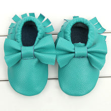Real leather moccasins with a feminine bow and fringe in aqua modern twist