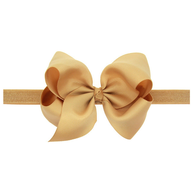 This modern classic beautifully voluminous dramatic, chic look gold headband for babies and toddlers