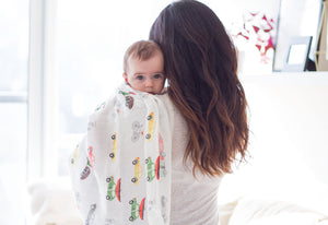 Modern, super soft, breathable cotton/bamboo muslin baby swaddle with transportation print on baby