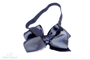This modern classic beautifully voluminous dramatic, chic look black headband for babies and toddlers