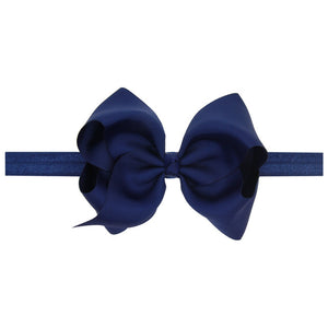 This modern classic beautifully voluminous dramatic, chic look navy headband for babies and toddlers