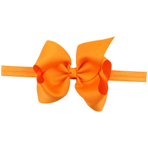 This modern classic beautifully voluminous dramatic, chic look orange headband for babies and toddlers