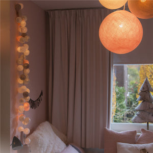 Delicate string of cotton ball lights handmade spheres soft colour combinations for teepee, canopy nursery decor, kids room lighting