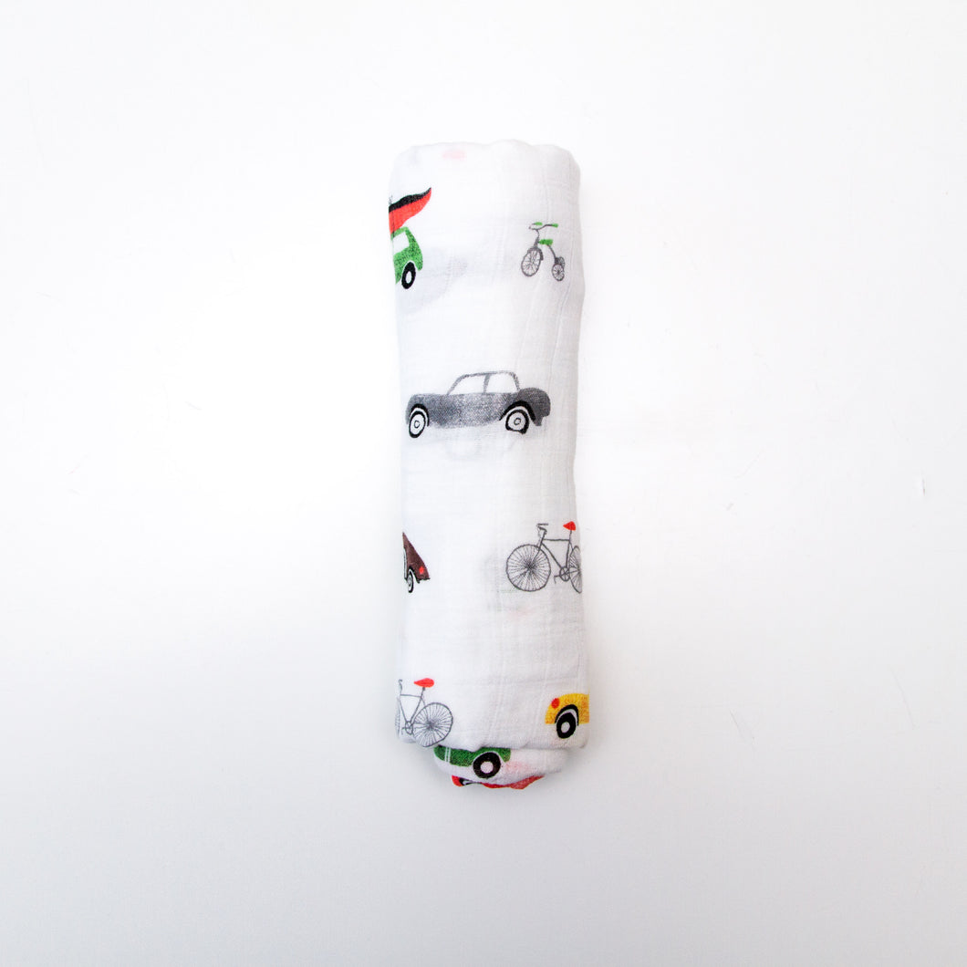 Modern, super soft, breathable cotton/bamboo muslin baby swaddle with transportation print colours