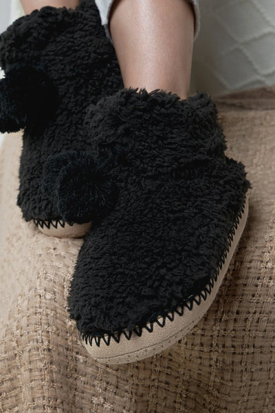 Black Slipper Bootie with Pom Pom from Southern Sunday, the boutique that gives back.  Southern Sunday offers the latest in ladies fashion and accessories at affordable prices.  Southern Sunday also offers a selection of gifts and home decor items.  Southern Sunday is located in Midway, KY, outside of Lexington, Kentucky.  Shop Southern Sunday online or in store at their boutique. Free shipping on orders over $75
