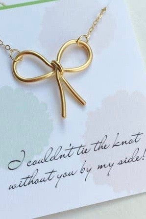 Gold or Silver Bow Necklace from Southern Sunday, the boutique that gives back.  Southern Sunday offers the latest in ladies fashion and accessories at affordable prices.  Southern Sunday also offers a selection of gifts and home decor items.  Southern Sunday is located in Midway, KY, outside of Lexington, Kentucky.  Shop Southern Sunday online or in store at their boutique. Free shipping on orders over $75