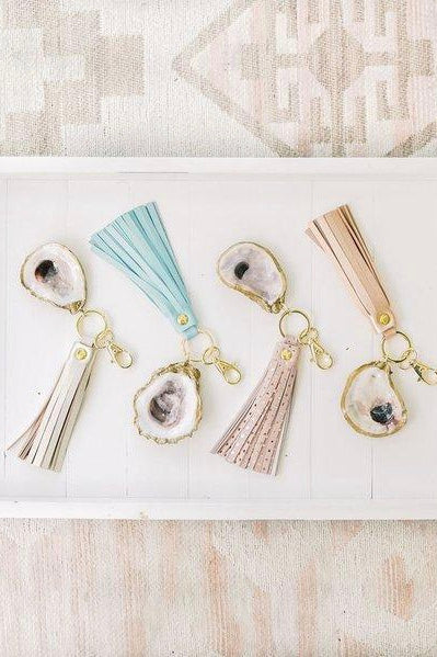 Oyster Shell Tassel Key Chain from Southern Sunday, the boutique that gives back. Southern Sunday offers the latest in ladies fashion and accessories at affordable prices. Southern Sunday also offers a selection of gifts and home decor items. Southern Sunday is located in Midway, KY, outside of Lexington, Kentucky. Shop Southern Sunday online or in store at their boutique.