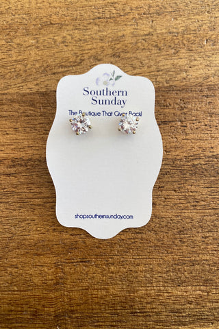 Silver Or Gold CZ Post Earring from Southern Sunday, the boutique that gives back.  Southern Sunday offers the latest in ladies fashion and accessories at affordable prices.  Southern Sunday also offers a selection of gifts and home decor items.  Southern Sunday is located in Midway, KY, outside of Lexington, Kentucky.  Shop Southern Sunday online or in store at their boutique. Free shipping on orders over $75