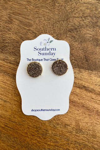 Charcoal Round Druzy Stone Post Earring from Southern Sunday, the boutique that gives back.  Southern Sunday offers the latest in ladies fashion and accessories at affordable prices.  Southern Sunday also offers a selection of gifts and home decor items.  Southern Sunday is located in Midway, KY, outside of Lexington, Kentucky.  Shop Southern Sunday online or in store at their boutique. Free shipping on orders over $75