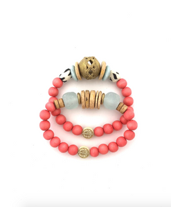 Coral Wooden Bead Bracelet Stack from Southern Sunday, the boutique that gives back.  Southern Sunday offers the latest in ladies fashion and accessories at affordable prices.  Southern Sunday also offers a selection of gifts and home decor items.  Southern Sunday is located in Midway, KY, outside of Lexington, Kentucky.  Shop Southern Sunday online or in store at their boutique. Free shipping on orders over $75