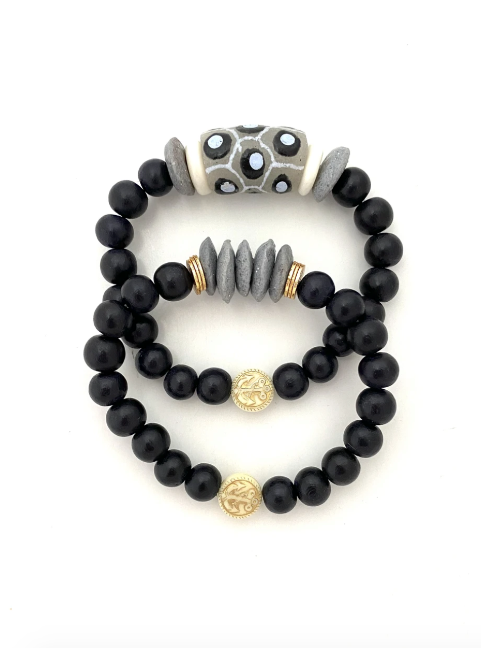 Black and Gray Beaded Bracelet Stack from Southern Sunday, the boutique that gives back.  Southern Sunday offers the latest in ladies fashion and accessories at affordable prices.  Southern Sunday also offers a selection of gifts and home decor items.  Southern Sunday is located in Midway, KY, outside of Lexington, Kentucky.  Shop Southern Sunday online or in store at their boutique. Free shipping on orders over $75