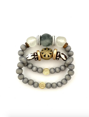 Gray Wooden Bead Bracelet Stack from Southern Sunday, the boutique that gives back.  Southern Sunday offers the latest in ladies fashion and accessories at affordable prices.  Southern Sunday also offers a selection of gifts and home decor items.  Southern Sunday is located in Midway, KY, outside of Lexington, Kentucky.  Shop Southern Sunday online or in store at their boutique. Free shipping on orders over $75