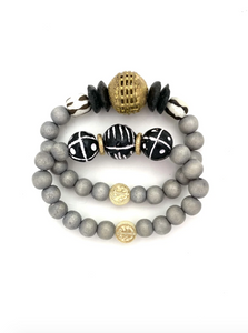 Gray, Black, and White Beaded Bracelet Stack from Southern Sunday, the boutique that gives back.  Southern Sunday offers the latest in ladies fashion and accessories at affordable prices.  Southern Sunday also offers a selection of gifts and home decor items.  Southern Sunday is located in Midway, KY, outside of Lexington, Kentucky.  Shop Southern Sunday online or in store at their boutique. Free shipping on orders over $75