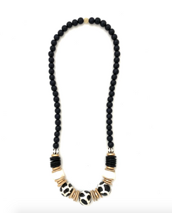 Black and White Long Classic Bead Necklace from Southern Sunday, the boutique that gives back.  Southern Sunday offers the latest in ladies fashion and accessories at affordable prices.  Southern Sunday also offers a selection of gifts and home decor items.  Southern Sunday is located in Midway, KY, outside of Lexington, Kentucky.  Shop Southern Sunday online or in store at their boutique. Free shipping on orders over $75