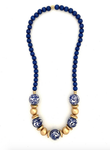 Blue Chinoiserie Bead Necklace from Southern Sunday, the boutique that gives back.  Southern Sunday offers the latest in ladies fashion and accessories at affordable prices.  Southern Sunday also offers a selection of gifts and home decor items.  Southern Sunday is located in Midway, KY, outside of Lexington, Kentucky.  Shop Southern Sunday online or in store at their boutique. Free shipping on orders over $75