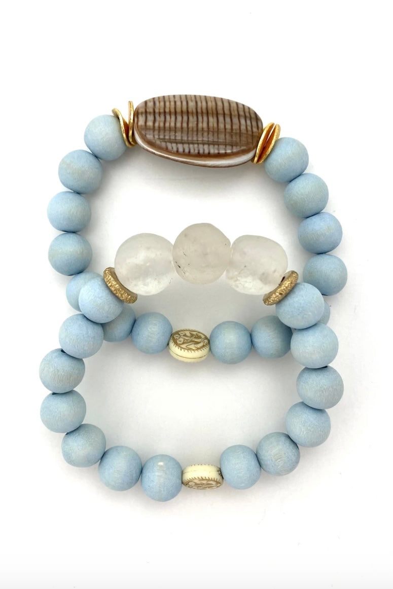 Light Blue Shell Bracelet Set from Southern Sunday, the boutique that gives back.  Southern Sunday offers the latest in ladies fashion and accessories at affordable prices.  Southern Sunday also offers a selection of gifts and home decor items.  Southern Sunday is located in Midway, KY, outside of Lexington, Kentucky.  Shop Southern Sunday online or in store at their boutique. Free shipping on orders over $75