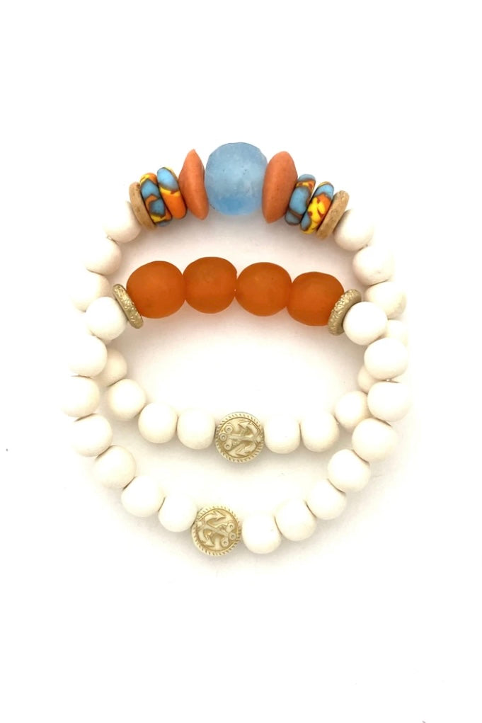 Orange, Blue and White Beaded Bracelet from Southern Sunday, the boutique that gives back.  Southern Sunday offers the latest in ladies fashion and accessories at affordable prices.  Southern Sunday also offers a selection of gifts and home decor items.  Southern Sunday is located in Midway, KY, outside of Lexington, Kentucky.  Shop Southern Sunday online or in store at their boutique. Free shipping on orders over $75