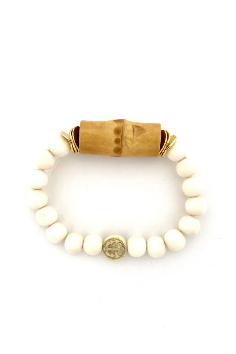 White Bead and Bamboo Bracelet from Southern Sunday, the boutique that gives back.  Southern Sunday offers the latest in ladies fashion and accessories at affordable prices.  Southern Sunday also offers a selection of gifts and home decor items.  Southern Sunday is located in Midway, KY, outside of Lexington, Kentucky.  Shop Southern Sunday online or in store at their boutique. Free shipping on orders over $75