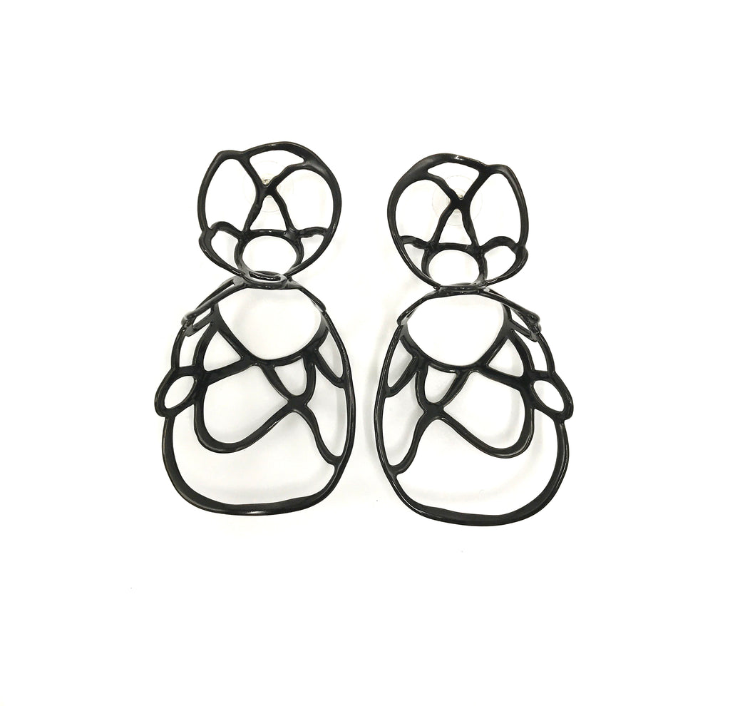 Black sculptural double lace statement earrings on white background.