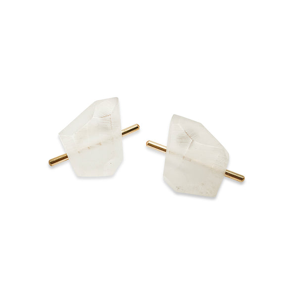 White acrylic rock stud earrings on white background.