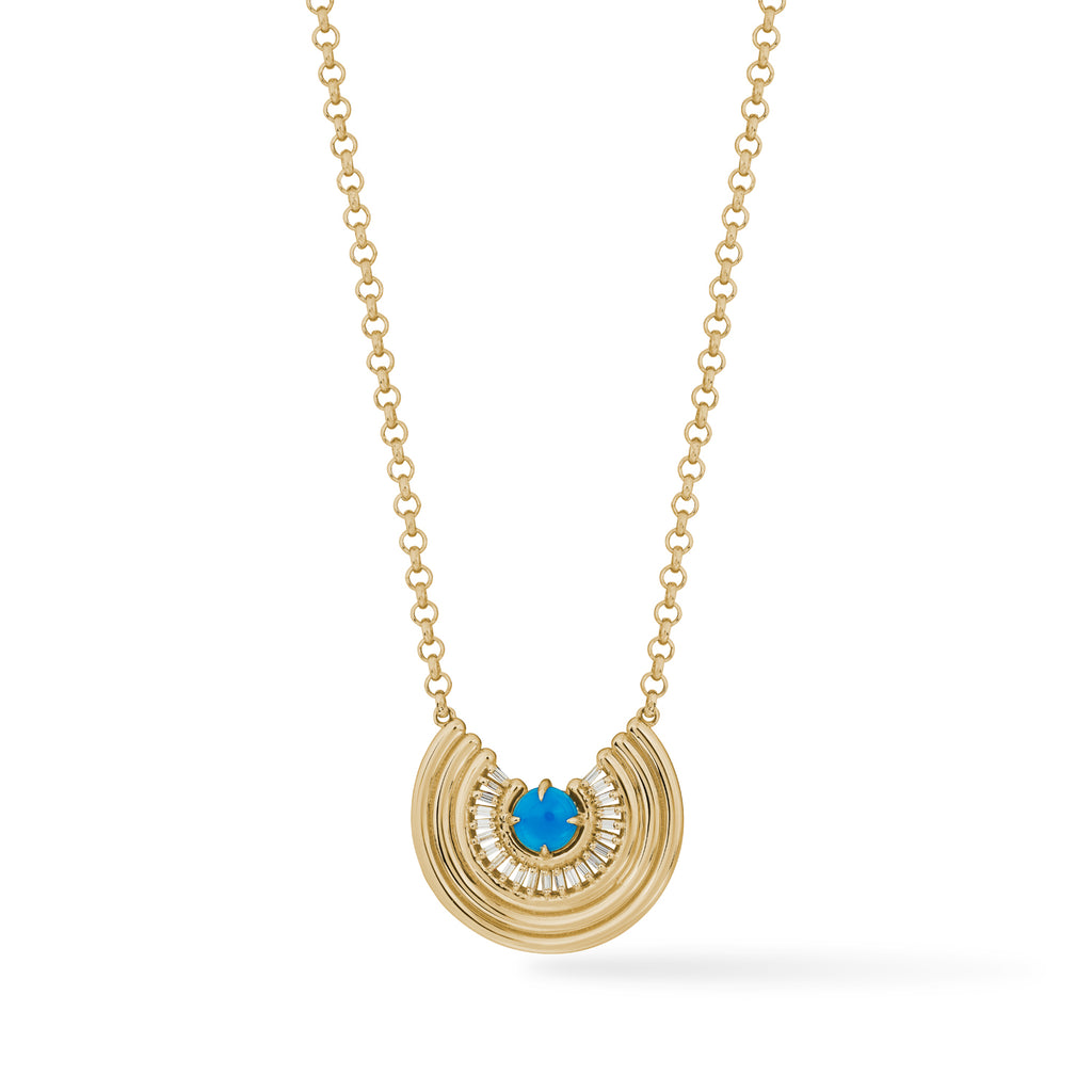 14k gold pendant with turquoise center stone surrounded by baguette shaped diamonds, close up on white background.