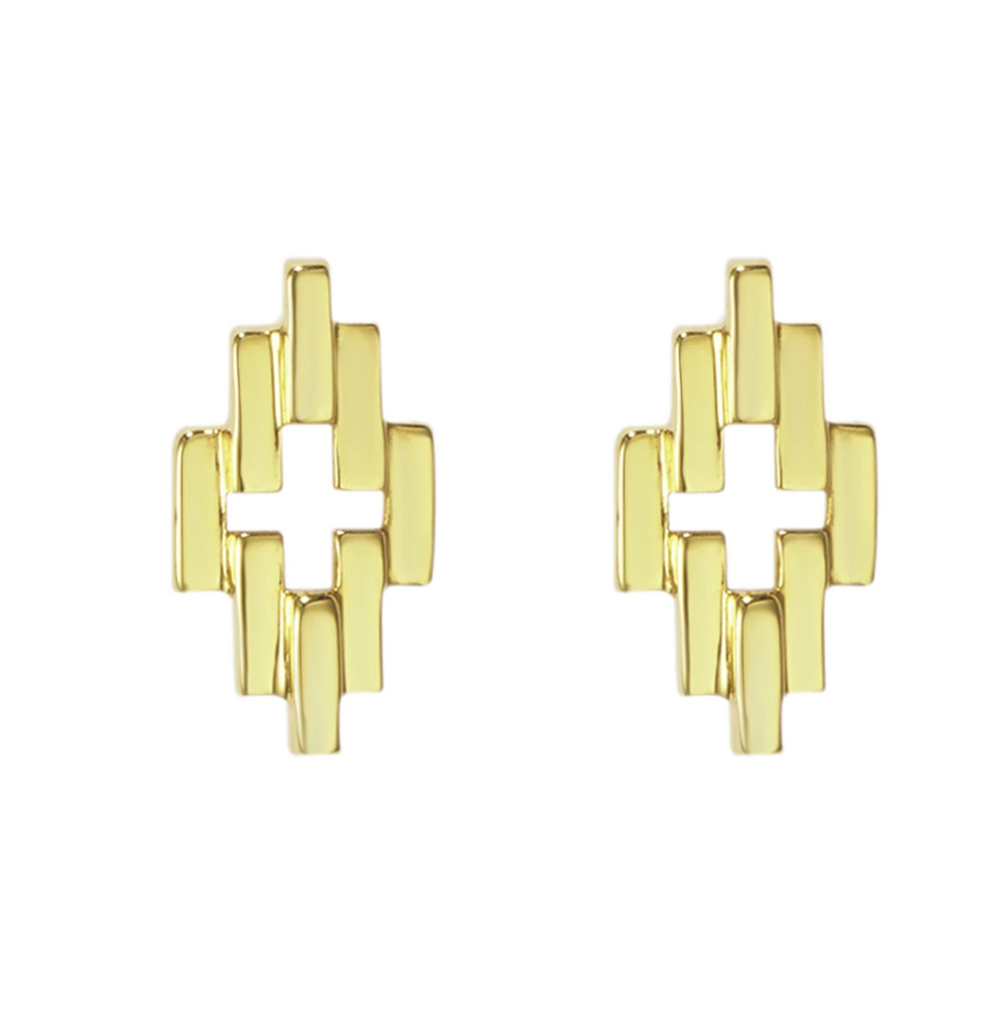 Gold zig zag studs on a white background
