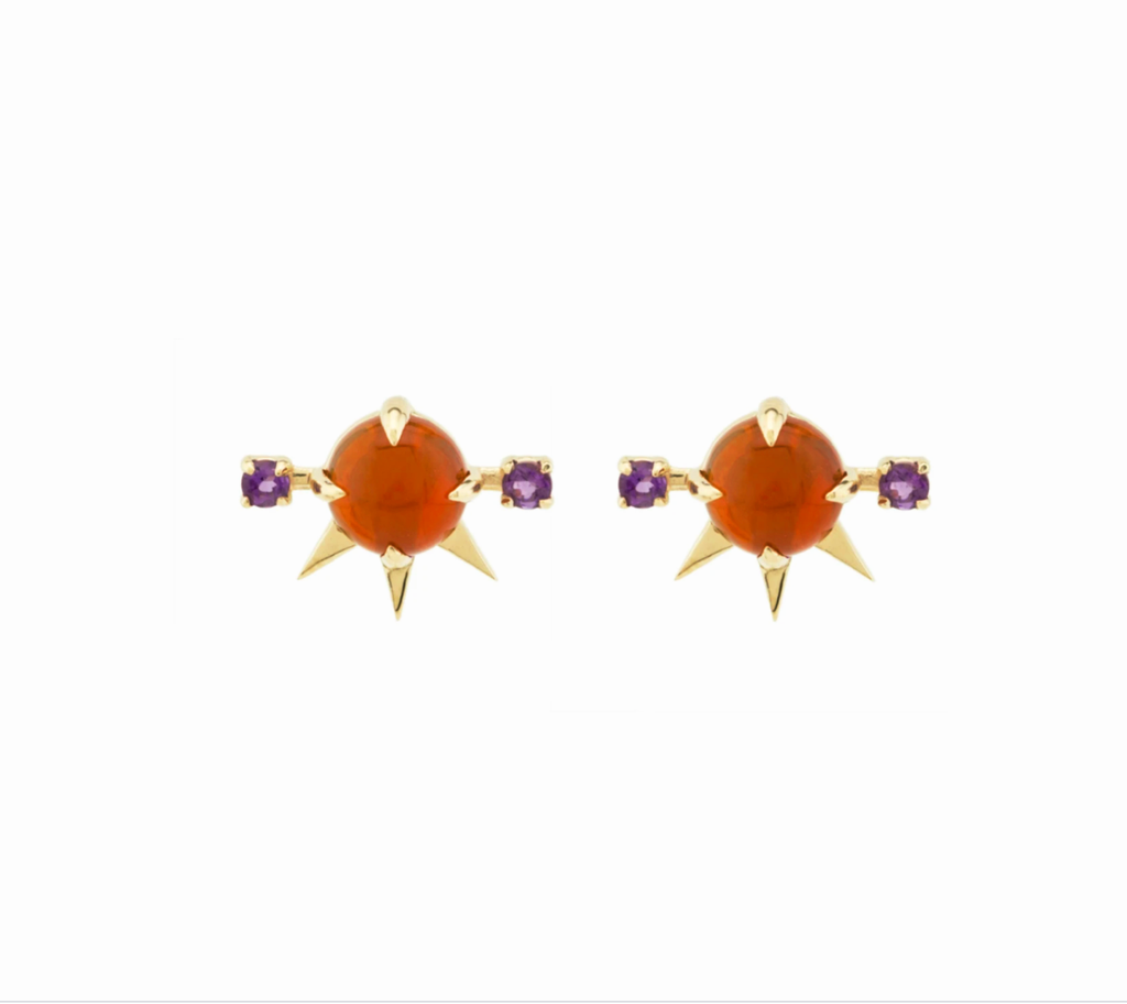 Fire opal studs with gold spikes and rhodolite garnet accents, on white background.