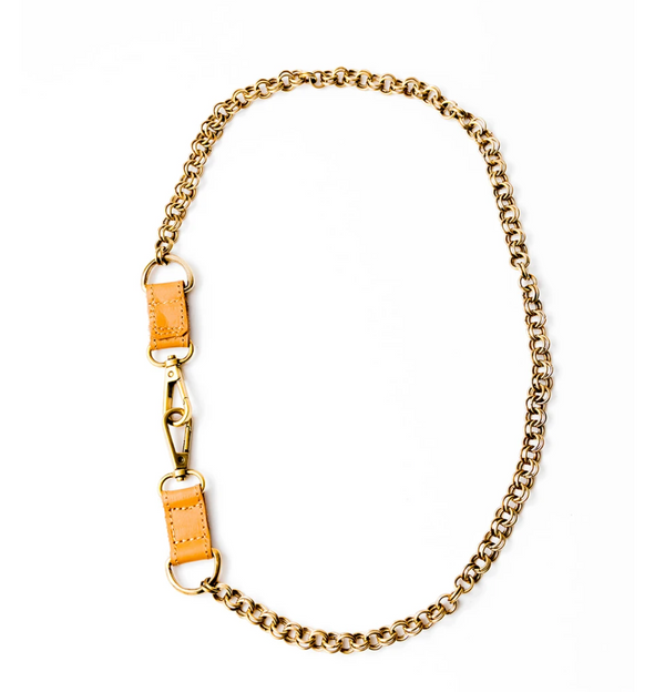 Brass chain necklace with leather detail, displayed on white background.