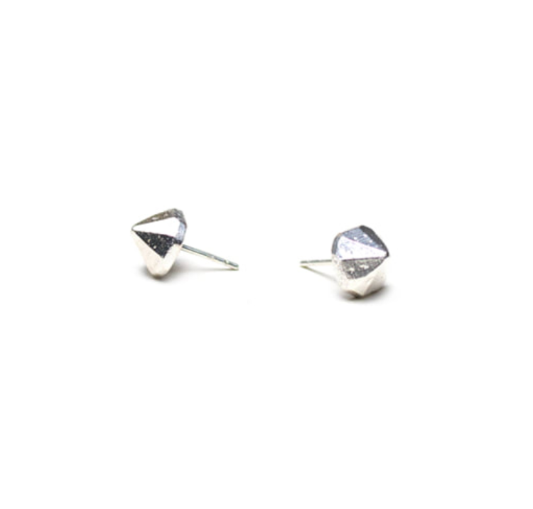 Silver cone shaped studs, on white background.