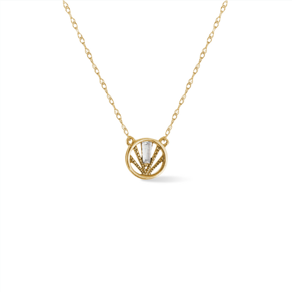 14k yellow gold, circle pendant with textural detail and baguette shaped diamond, close up on white background.