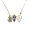 14k gold pendant necklace with labradorite, tanzanite, and rainbow moonstone teardrop gemstones, close up on white background.
