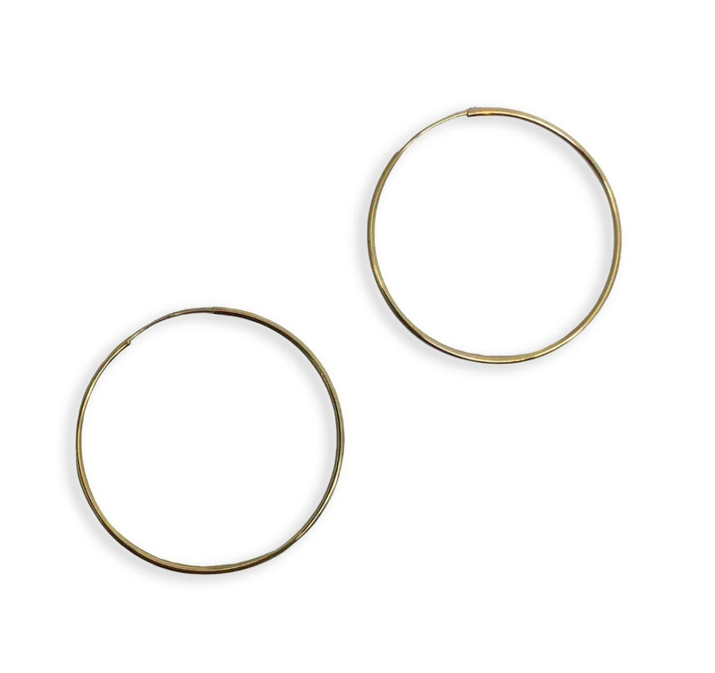 14k yellow gold thin hoops, on white background.
