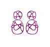 Fuchsia sculptural double lace statement earrings on white background.