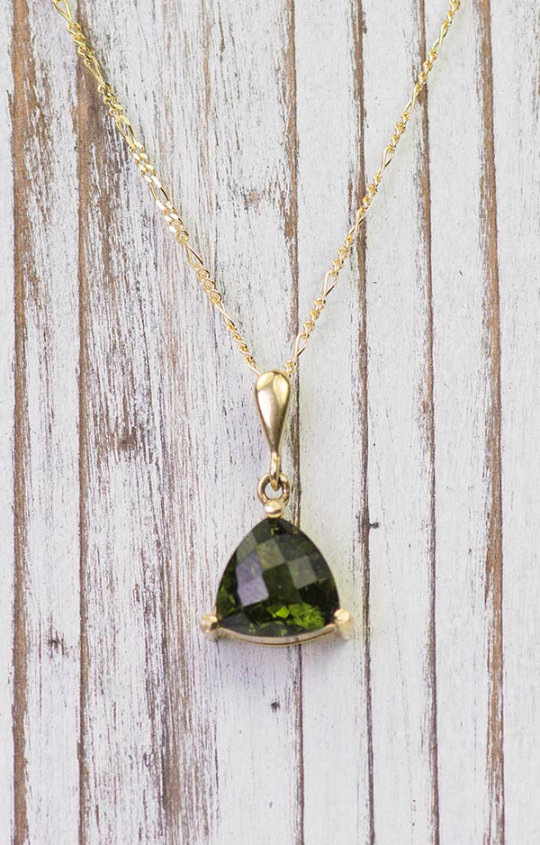 Pendant with faceted Czech moldavite and garnets white and yellow gold 925 Sterling Silver 22 K 585 White Gold 14 K 585 Yellow Gold 14 K