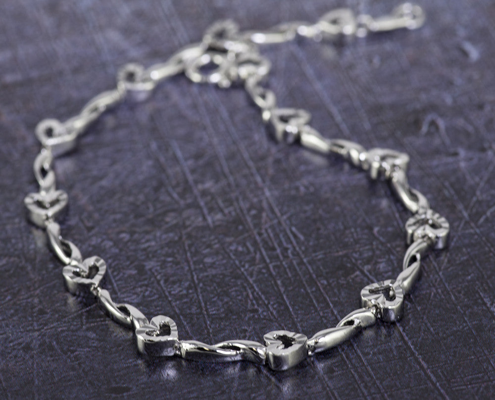 Large Sterling Silver Diamond Cut Hearts Bracelet