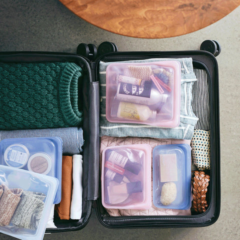 suitcase organized with stasher bags