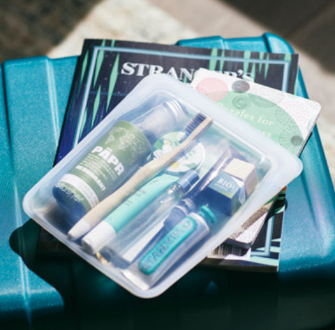 Stasher Quart bag packed with travel toiletries