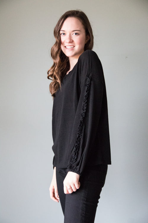 black mini ruffle sweater