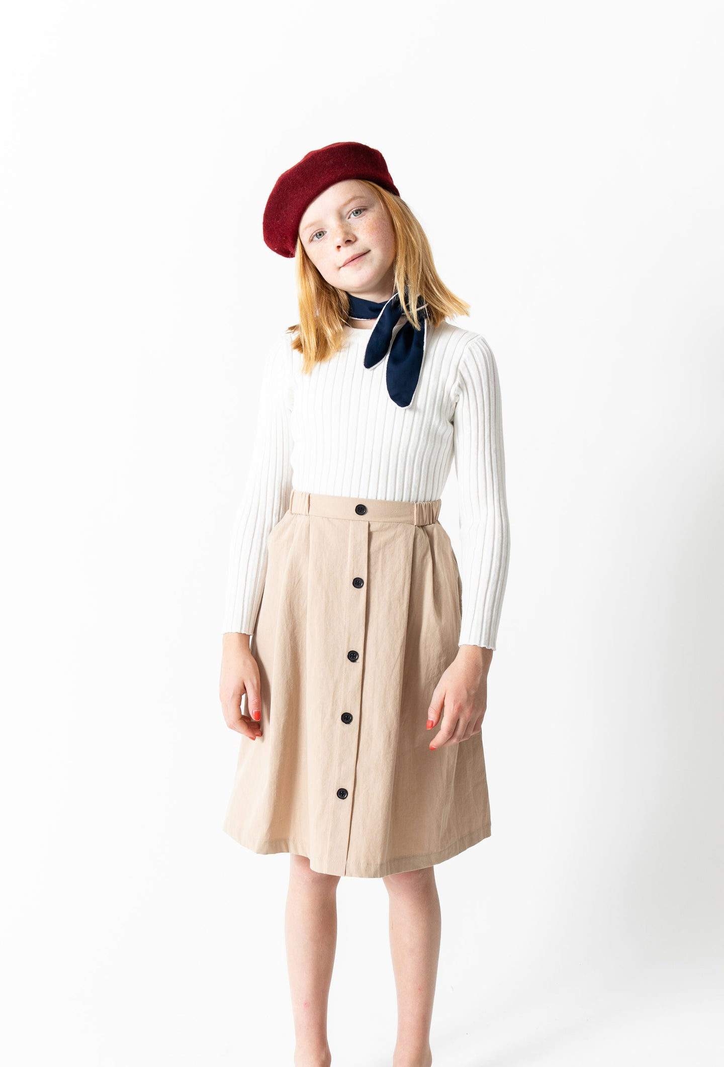 PLEATED BUTTON SKIRT