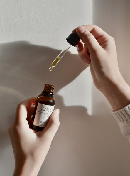 BY SARAH LONDON - Organic Facial Oil and pipette in hand
