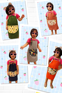 台灣師傅手工小小孩工作圍裙  Taiwanese tailor handmade adjustable working apron with printed cartoon pocket -米白搗蛋貓 - Gloria's Bookstore 灣區中文繪本童書專賣